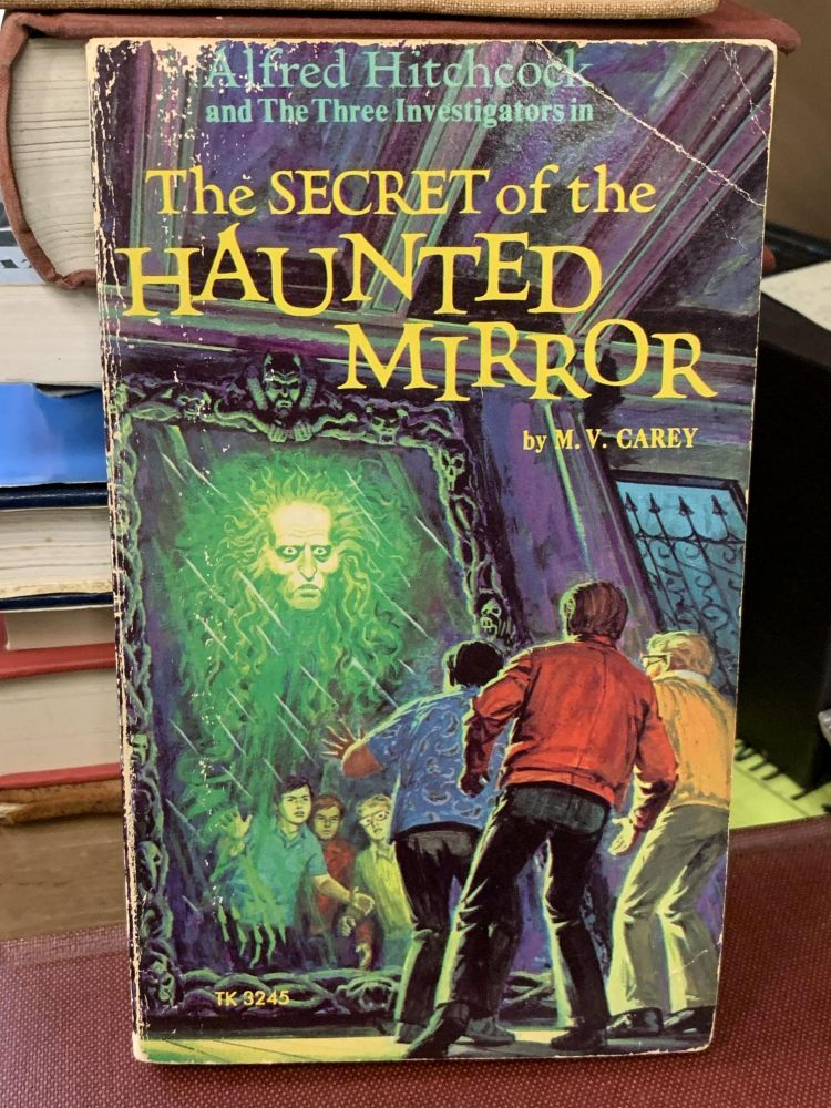 Alfred Hitchcock and The Three Investigators in The Secret of the Haunted Mirror. M. V. Carey.